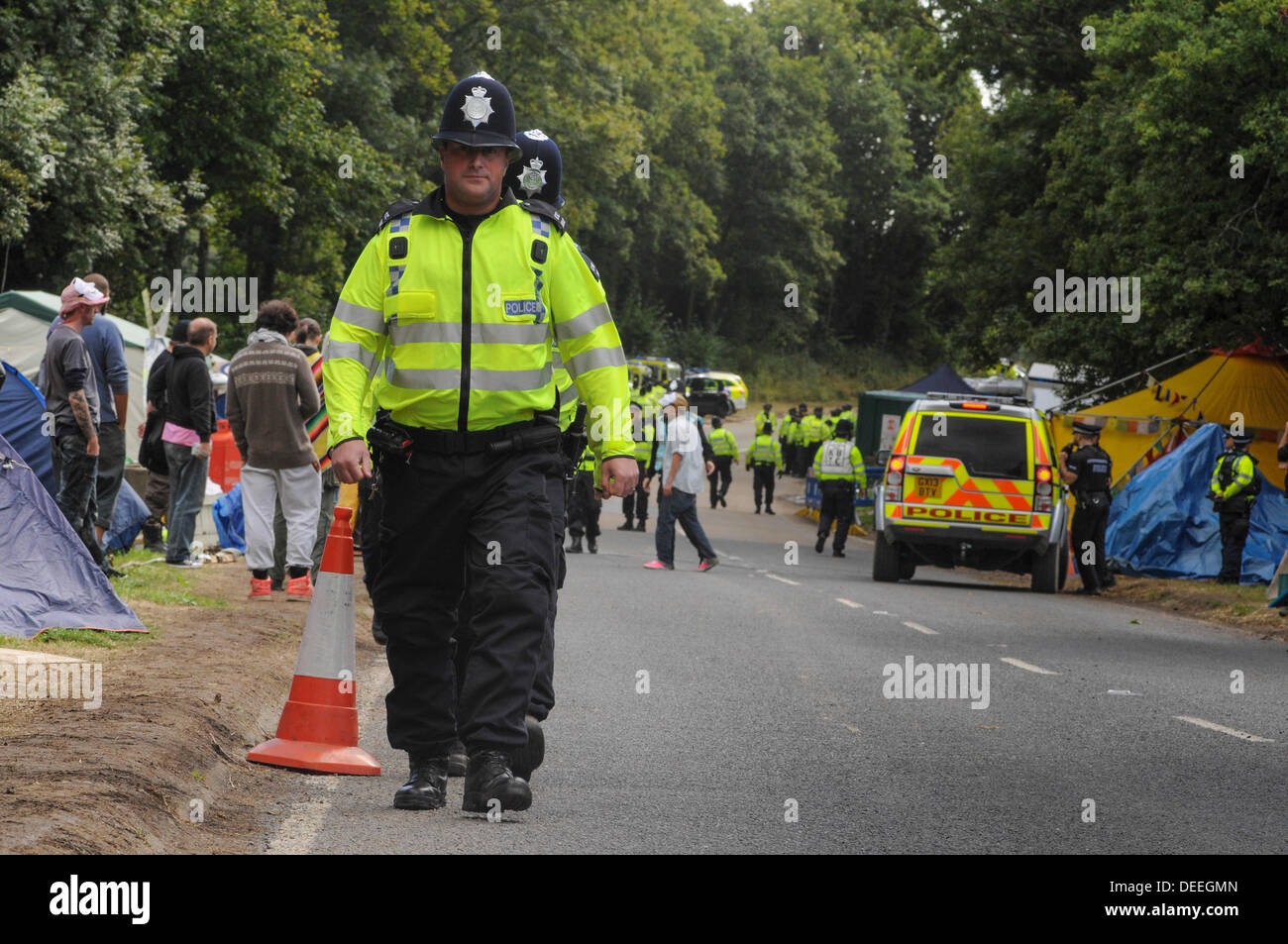 Balcombe, West Sussex, UK. 16th Sep, 2013. Environmental protesters watch as Police prepare to line the roadside for another lorry departure from the Cuadrilla site. Protesters lately have not seen to be disrupting Police in their duties and the atmosphere has been very relaxed and amicable. .Environmentalists rejoiced after todays failed attempt by West Sussex County  in the high court, due flawed case, to evict them from the road side camp. © David Burr/Alamy Live News - Stock Image