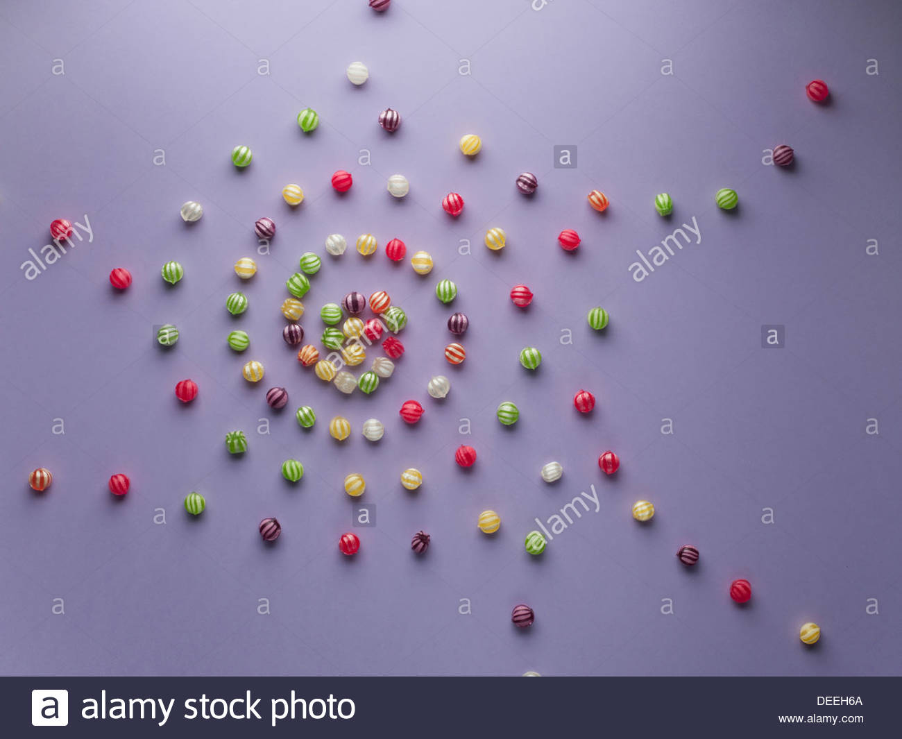Spiral of vibrant hard candy - Stock Image