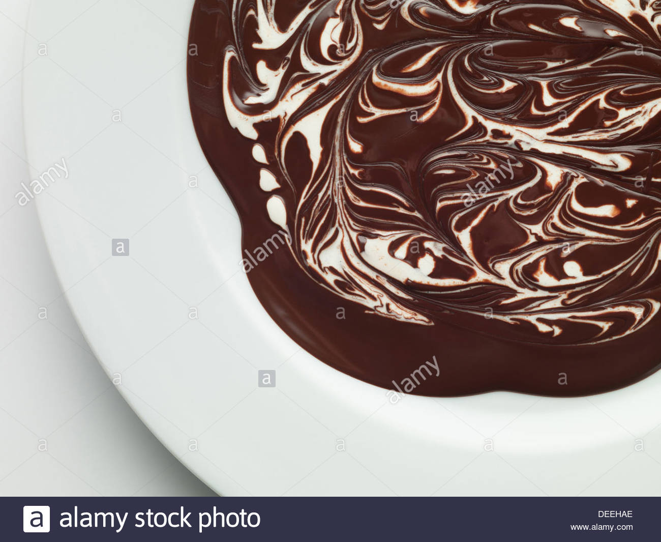 Bowl of melted chocolate - Stock Image