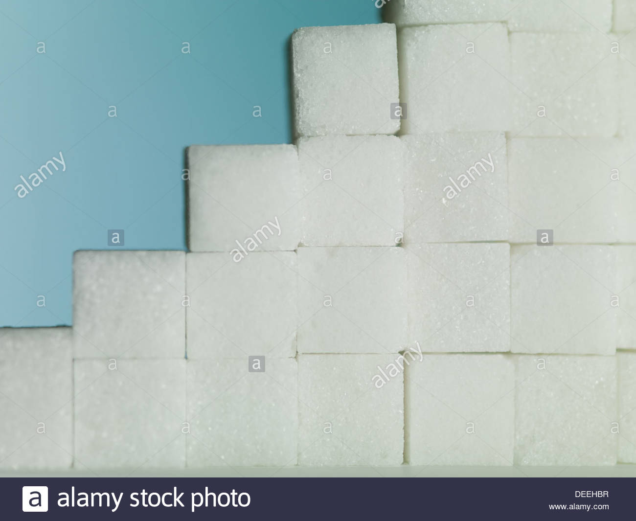 close up of Sugar cubes forming steps - Stock Image