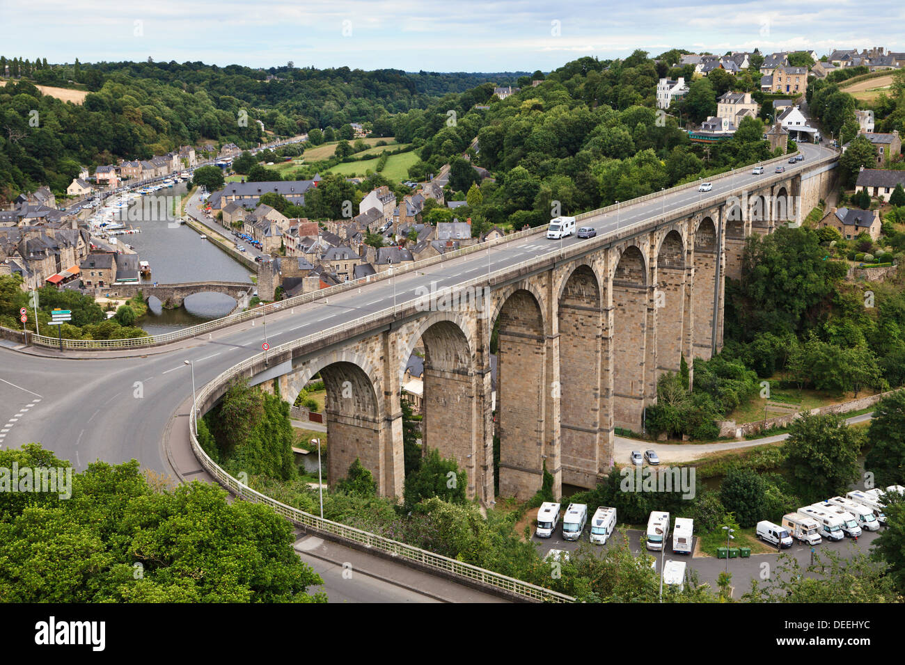 A motorhome crosses the viaduct above the Old Port and River Rance at Dinan, Côtes-d'Armor, Brittany, France Stock Photo