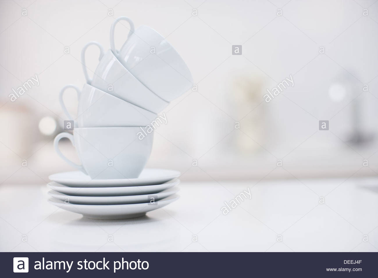Stack of coffee cups - Stock Image