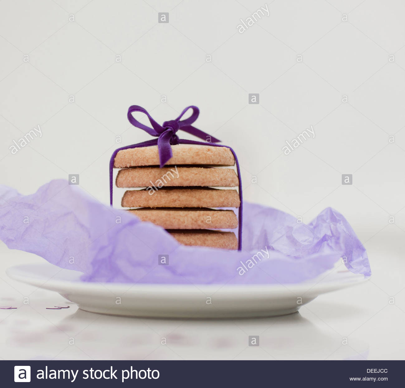 Close up of ribbon around stack of cookies - Stock Image