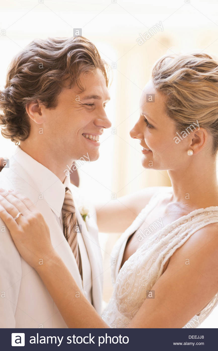 Bride and groom hugging - Stock Image