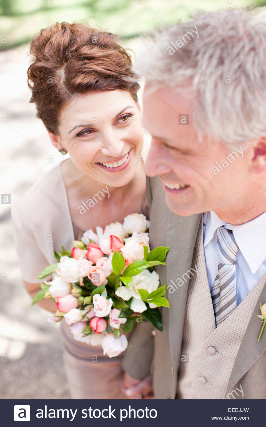 Mature bride and groom smiling - Stock Image