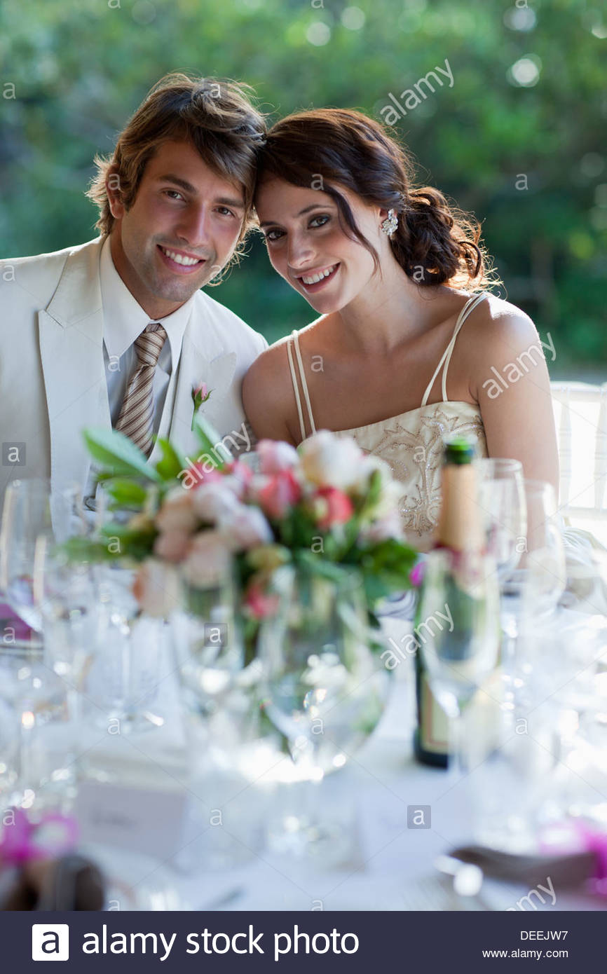Bride and groom smiling - Stock Image