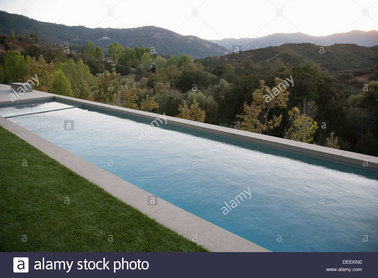 Swimming pool and distant hills - Stock Image