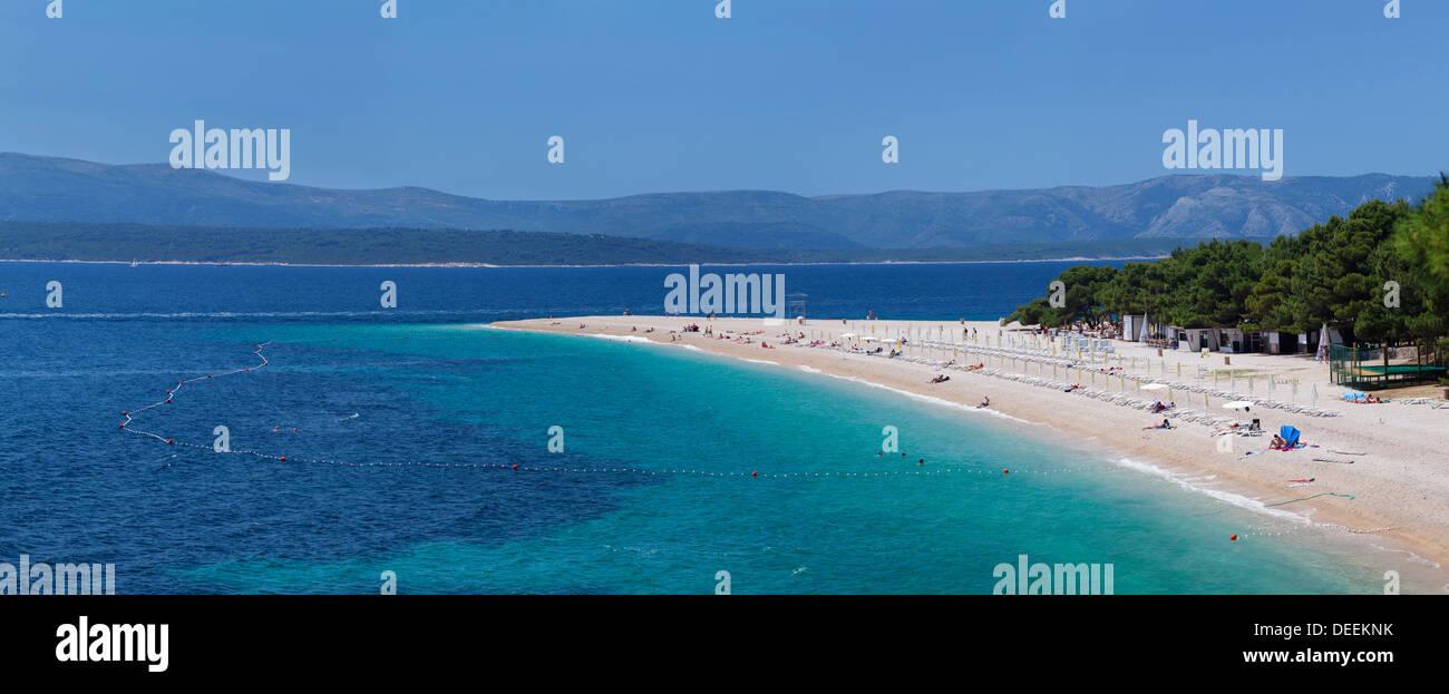Beach of Zlatni rat (Golden Horn) and the island of Hvar in the background, Bol, Brac, Dalmatia, Croatia, Europe - Stock Image