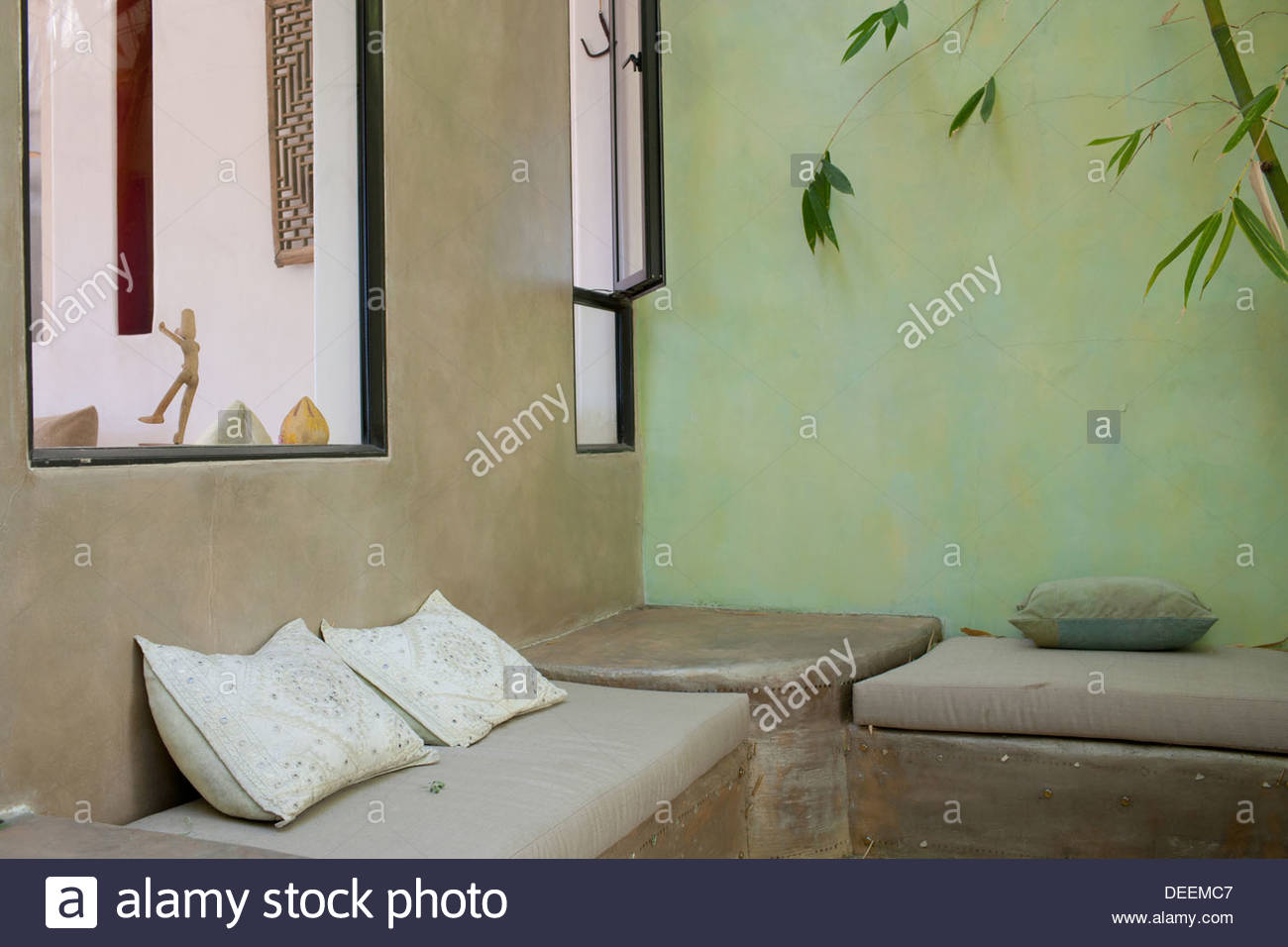 Outdoor seating area with bamboo - Stock Image