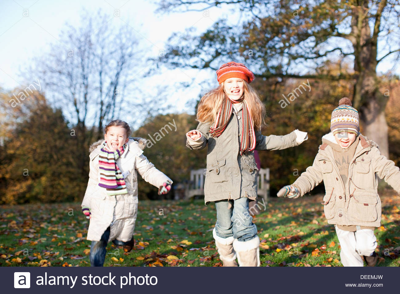 Children playing outdoors in autumn - Stock Image