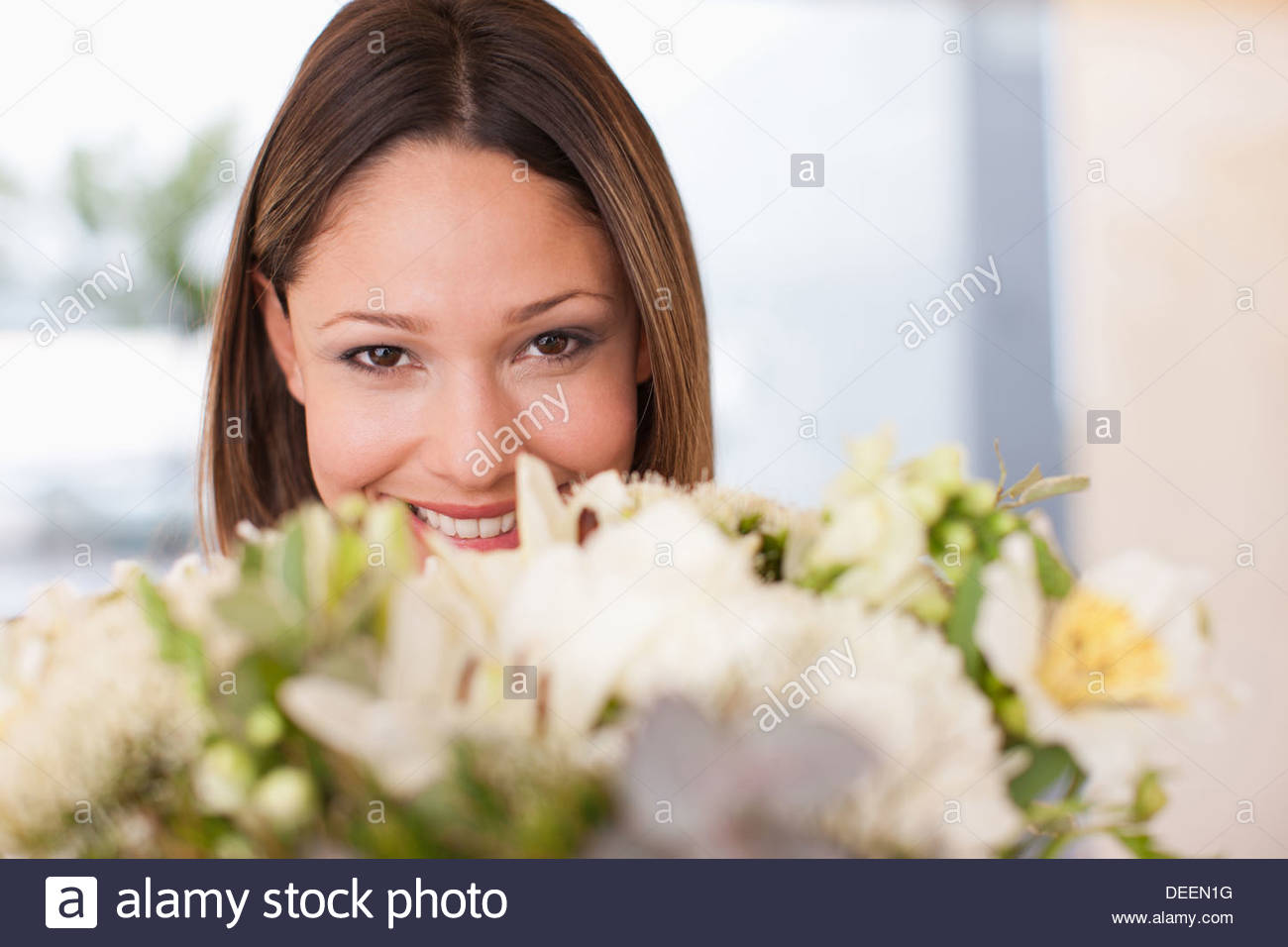 Woman holding bouquet of flowers - Stock Image