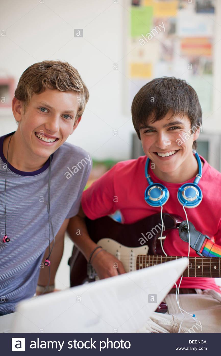 Teenage boy playing electric guitar - Stock Image