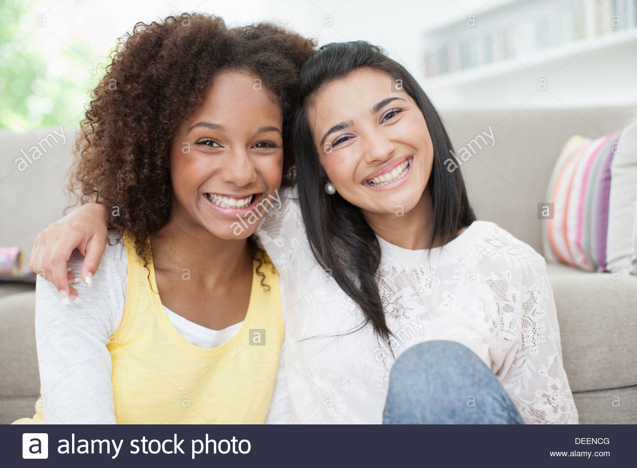 Smiling teenage girls hugging Stock Photo