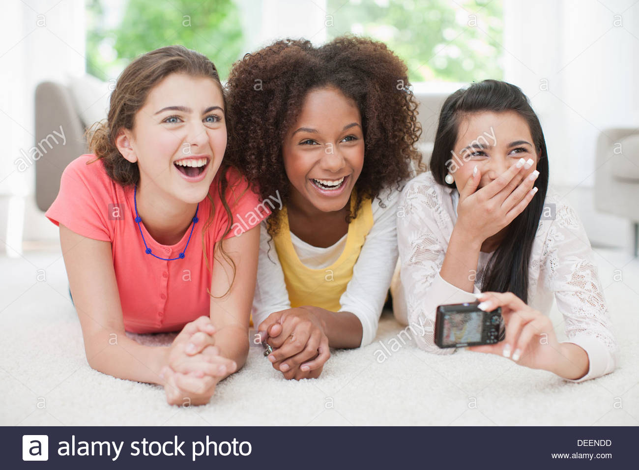 Teenage girls taking self-portrait - Stock Image