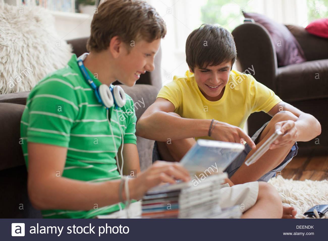 Teenage boys looking at cd roms - Stock Image