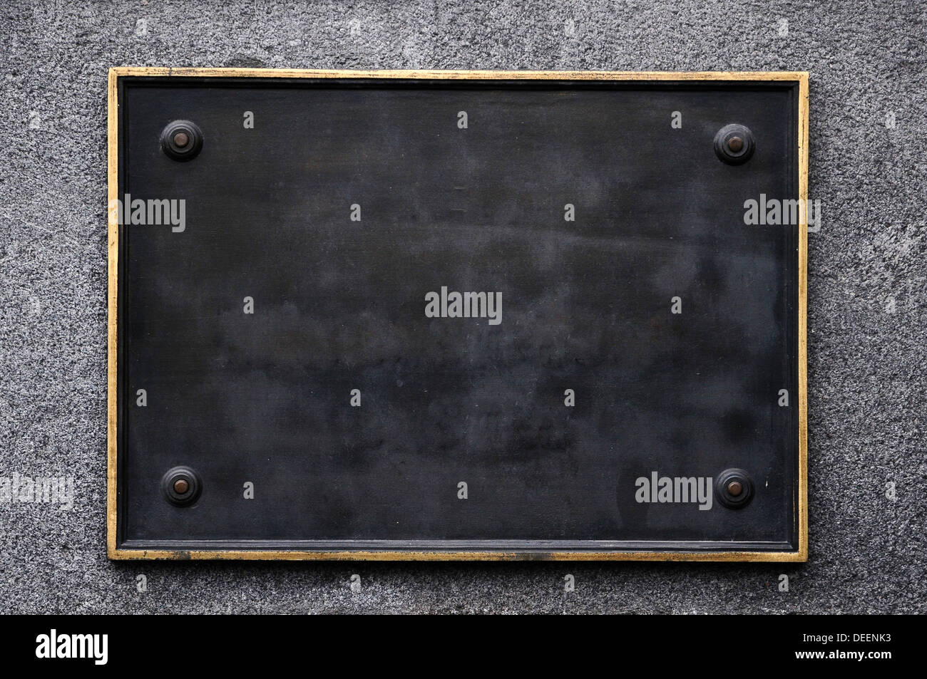 old weathered black street sign hanging on wall Stock Photo