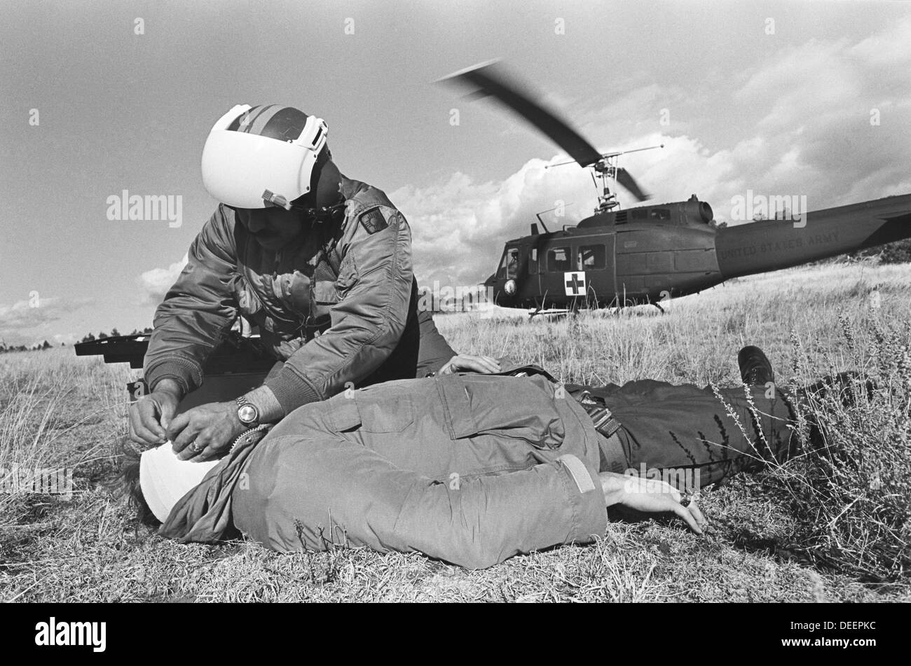 A New Mexico Air National Guard helicopter rescues an injured hunter from a mountaintop in northern New Mexico, circa 1976 - Stock Image