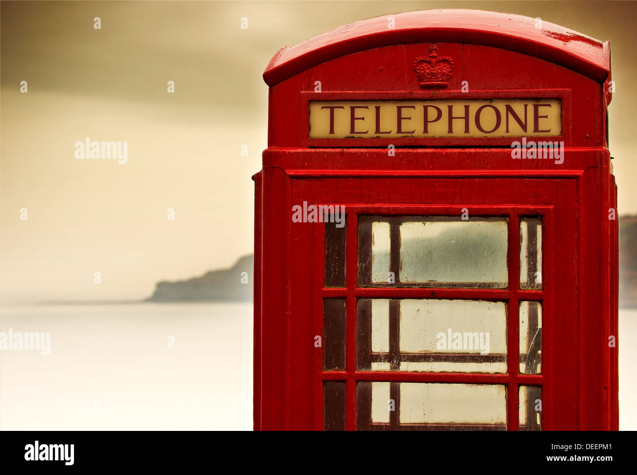 Traditional British red telephone box by the sea - Stock Image