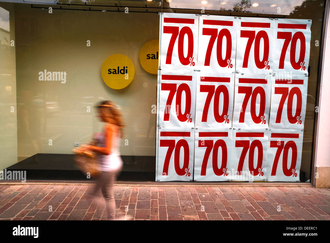 Seventy percent discount sale in a shop, Pescara, Italy. - Stock Image