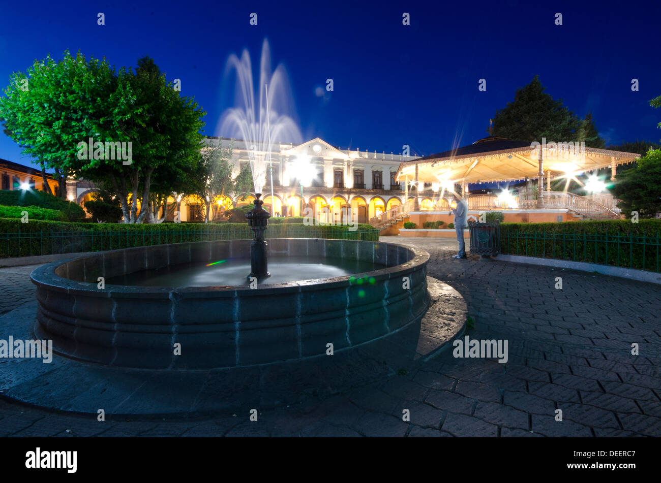 Night time in main plaza in Zacatlan in Central Mexico showing fountain and bandstand Stock Photo