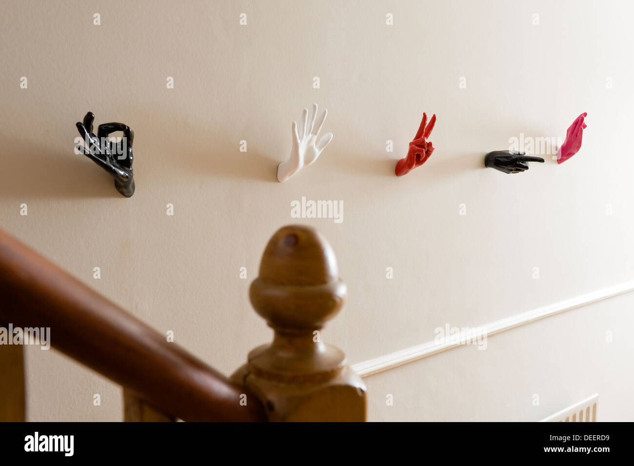 Wall mounted sculptural hands provide unusual coat hooks - Stock Image & Coat Hooks And Wall Stock Photos \u0026 Coat Hooks And Wall Stock Images ...