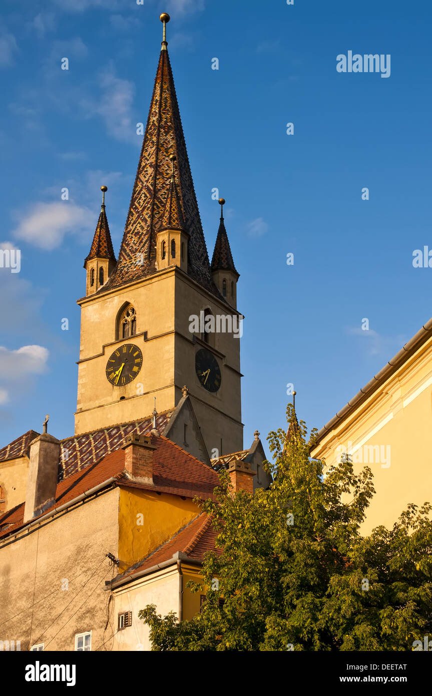 church from historic center in sibiu (Hermannstadt) at sunset - Stock Image