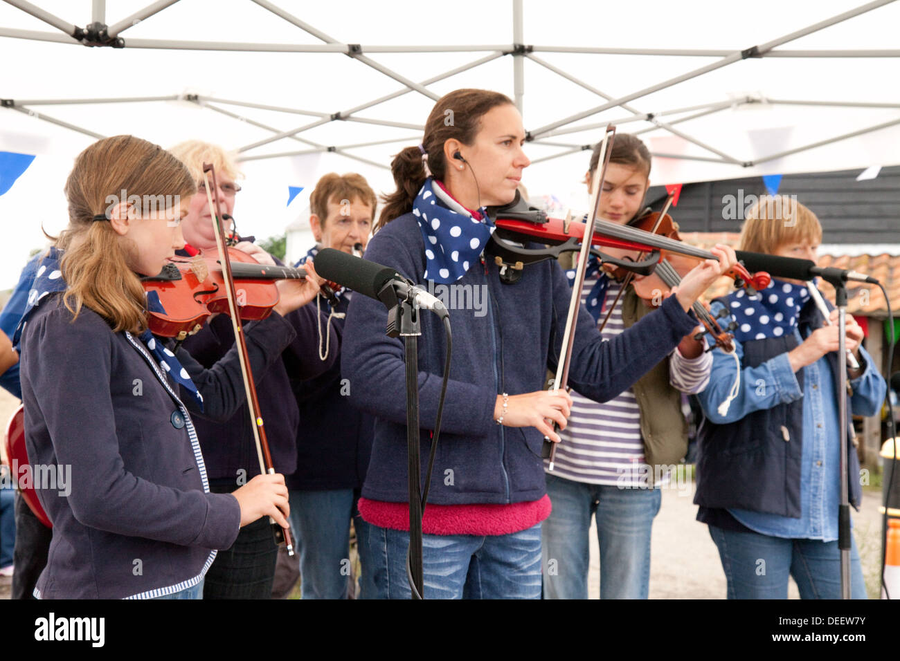 A local folk group playing at Orford Village fair, Suffolk England UK - Stock Image