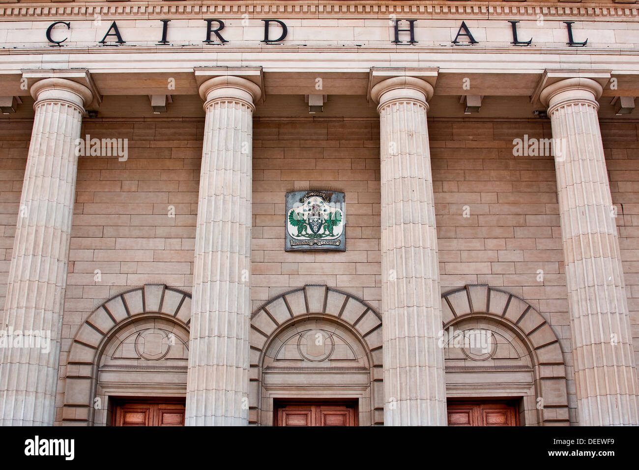 Close-up view of the Doric columns and arched doors at the main entrance of the Caird Hall in Dundee, UK Stock Photo