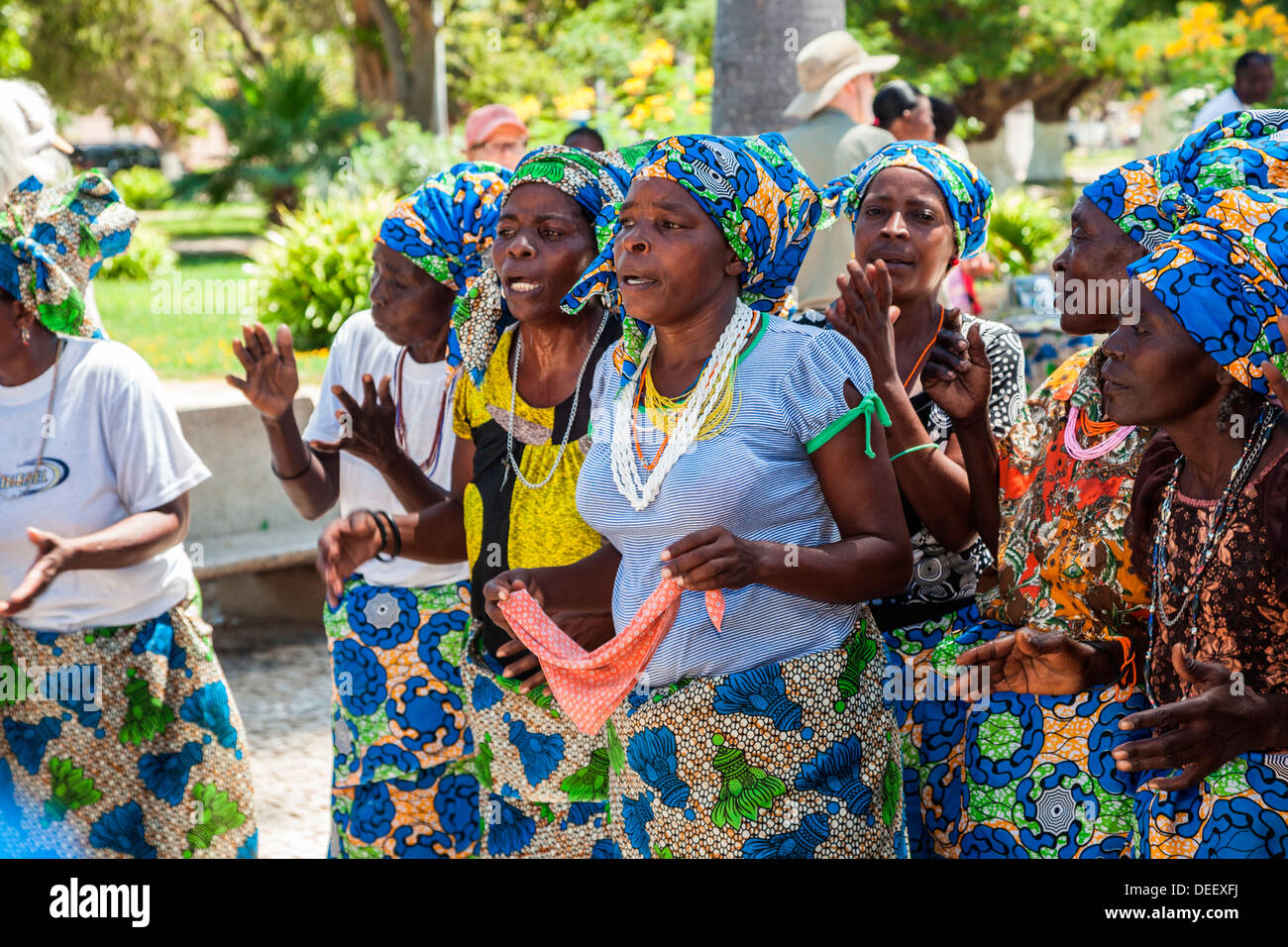Africa, Angola, Benguela. Woman dancing in town square. Stock Photo