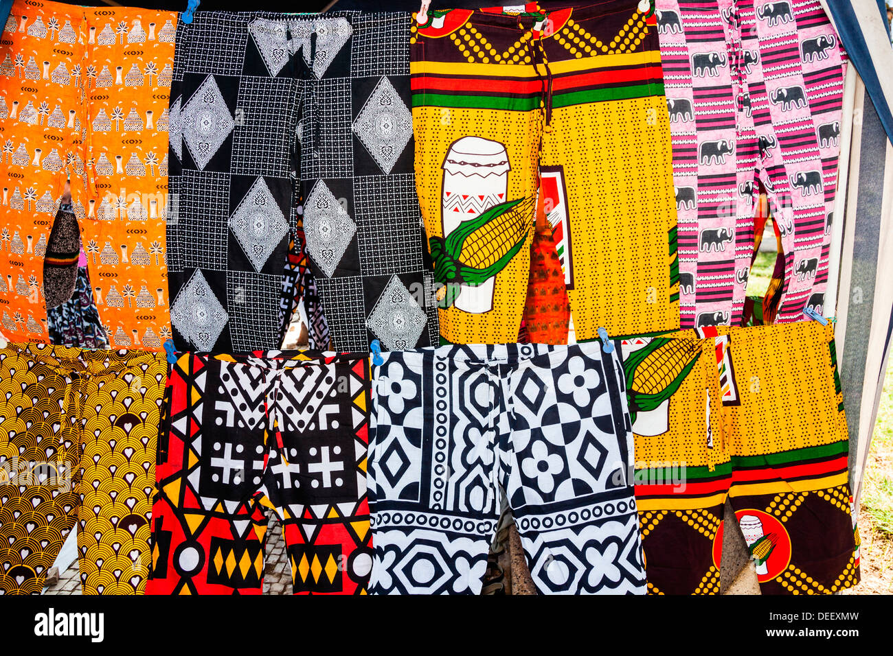 Africa, Angola, Benguela. Brightly colored pants for sale at local shop. - Stock Image