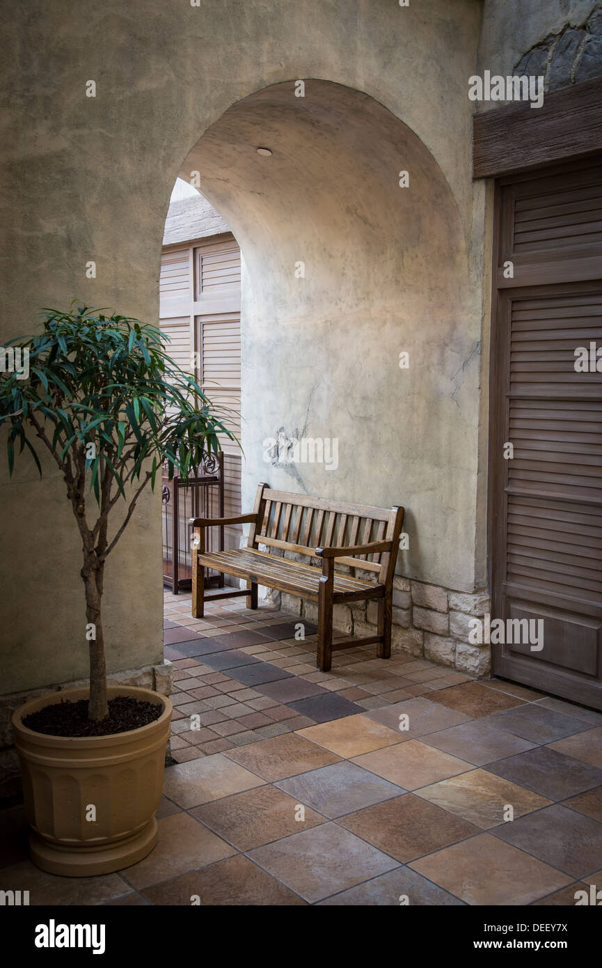 Courtyard Arched Doorway With Bench - Stock Image