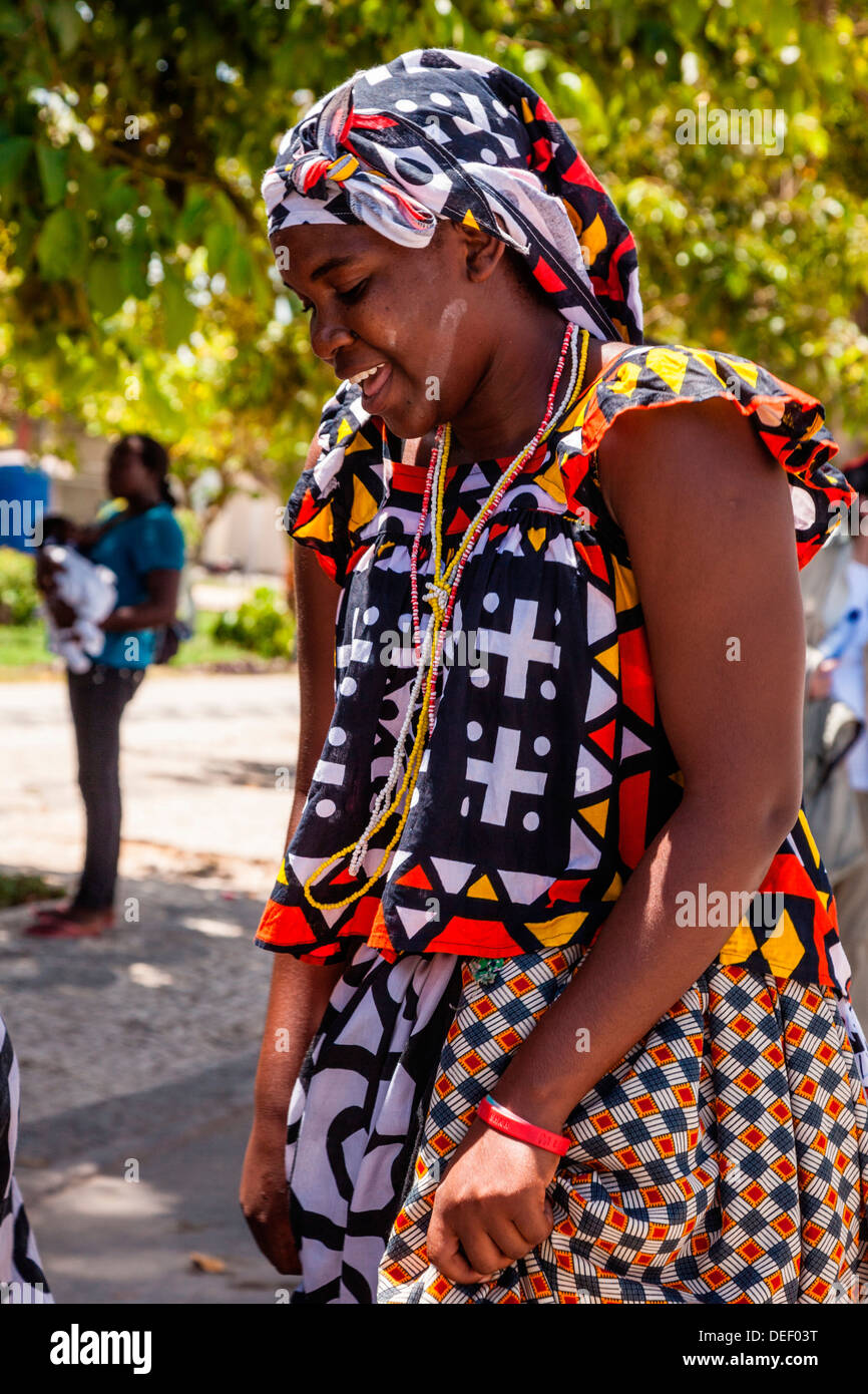Africa, Angola, Benguela. Woman dancing in traditional dress. - Stock Image