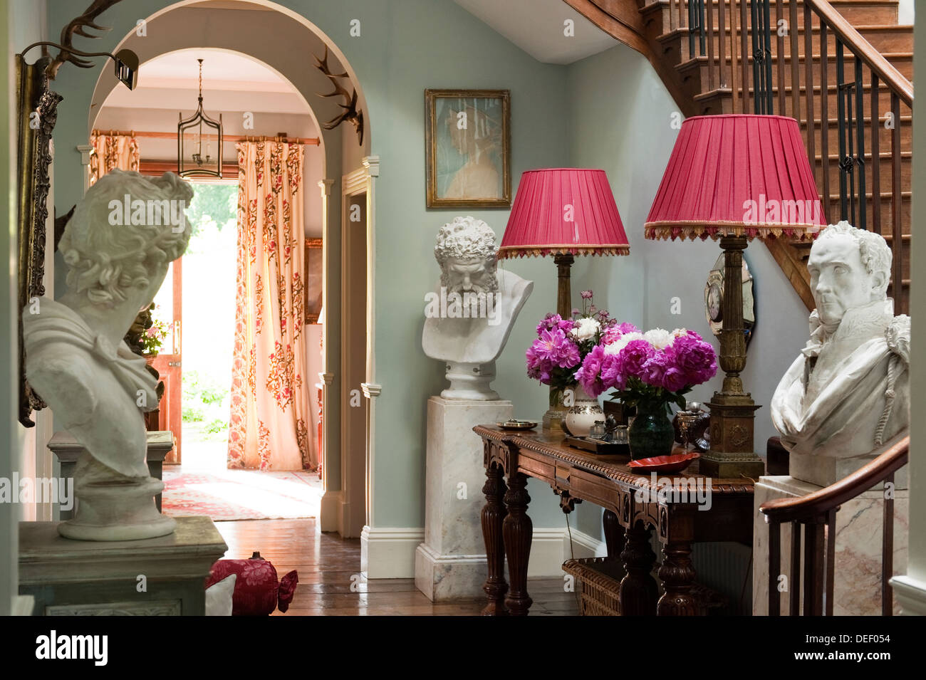 Country Estate entrance hallway with busts of human heads - Stock Image