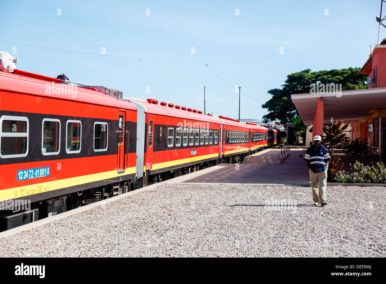 Africa, Angola, Lobito. Man standing beside train. Stock Photo
