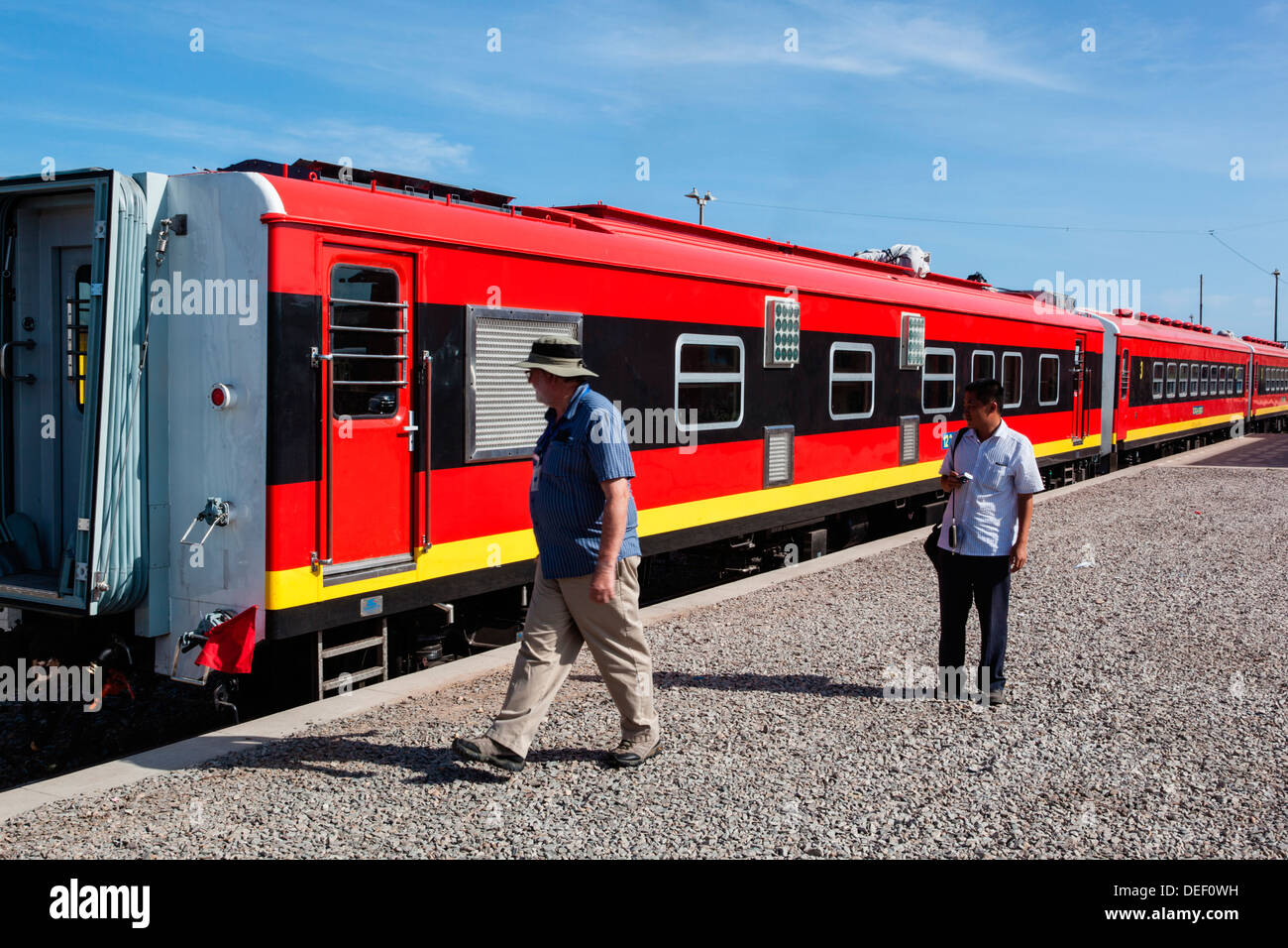 Africa, Angola, Lobito. Men standing beside train. Stock Photo