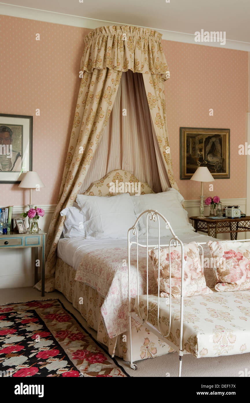 Farmhouse Bedroom With Fabric Canopy And Wrought Iron Seat Stock Photo Alamy