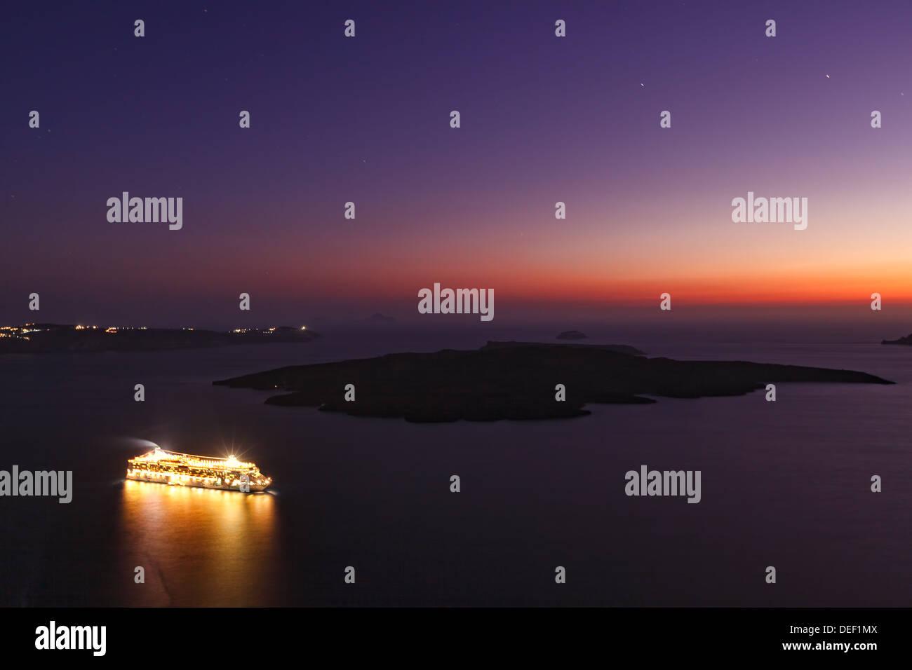 A ship doing a cruise in Santorini, Greece - Stock Image