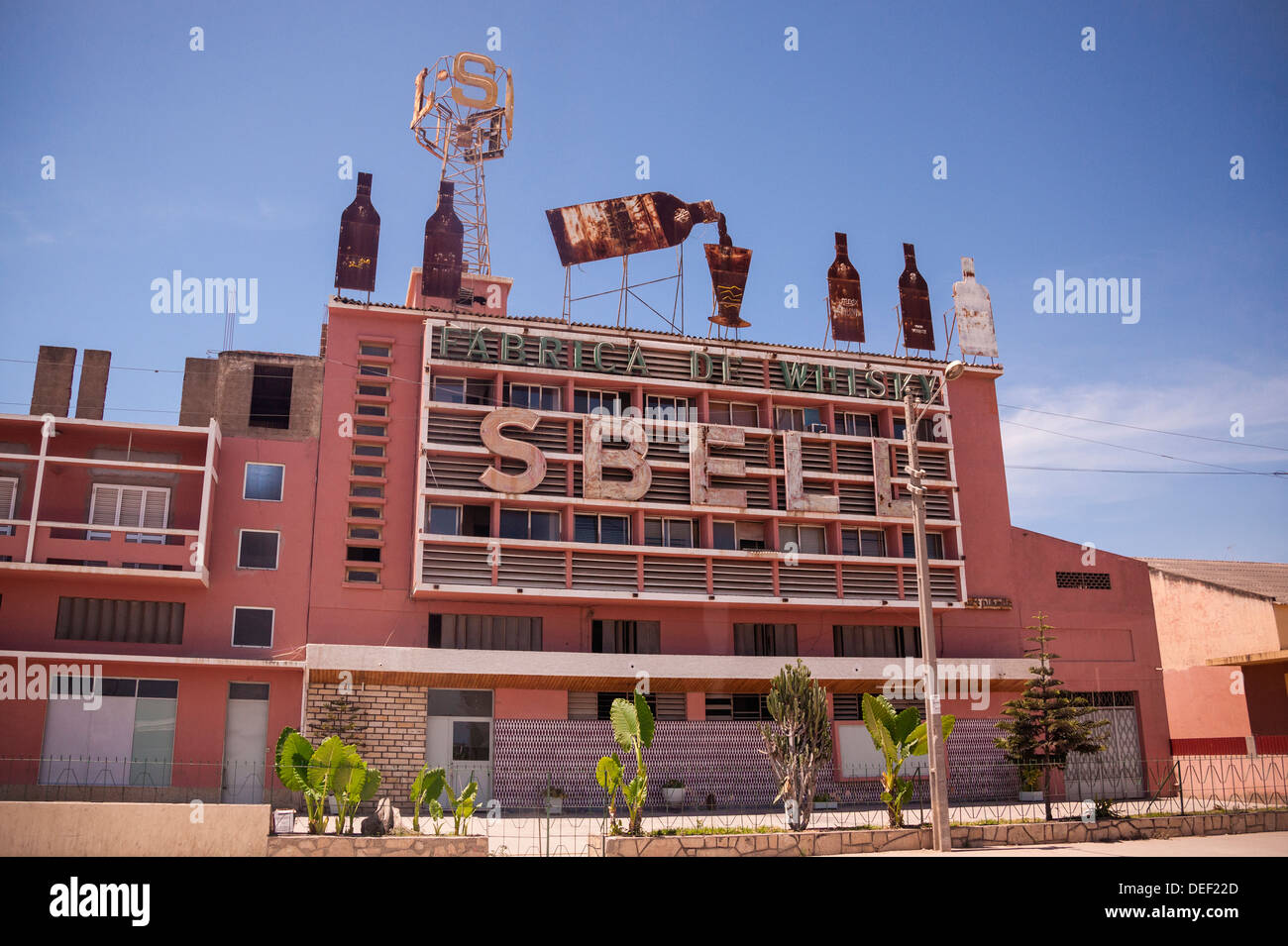 Africa, Angola, Lobito. Roadside shot of Sbell Whiskey factory. - Stock Image