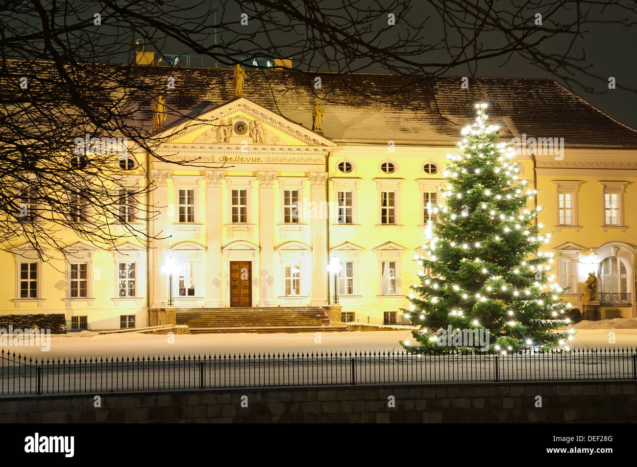 Christmas tree in front of bellevue palace in winter at nicht in Berlin, Germany - Stock Image