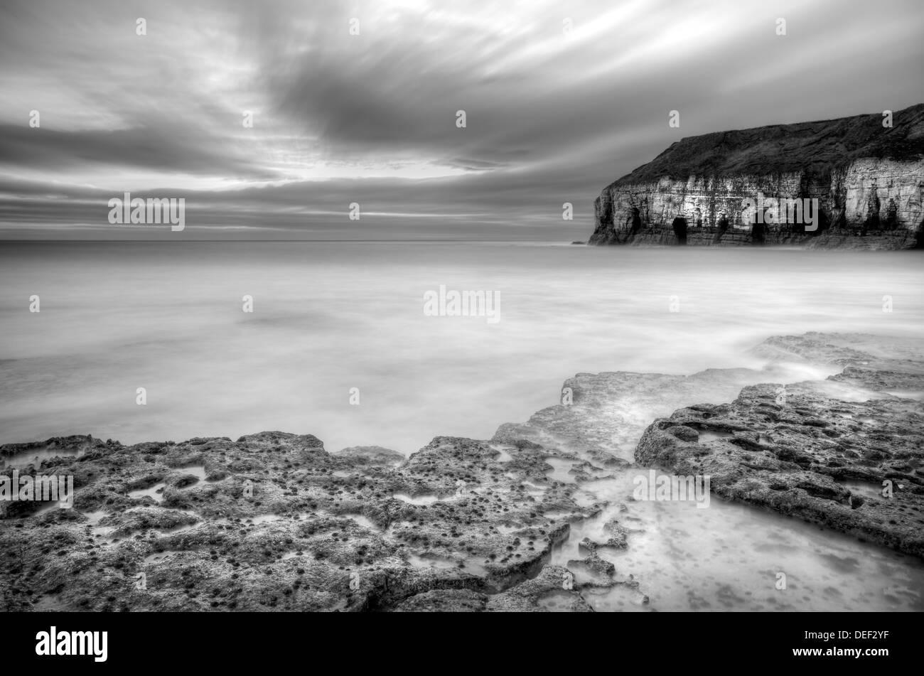 Long Exposure of Thornwick Bay, Flamborough Head, North Yorkshire Stock Photo