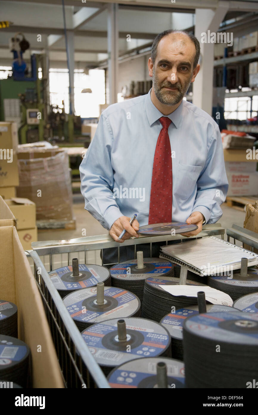 Industrial director. Abrasive discs manufacture. - Stock Image