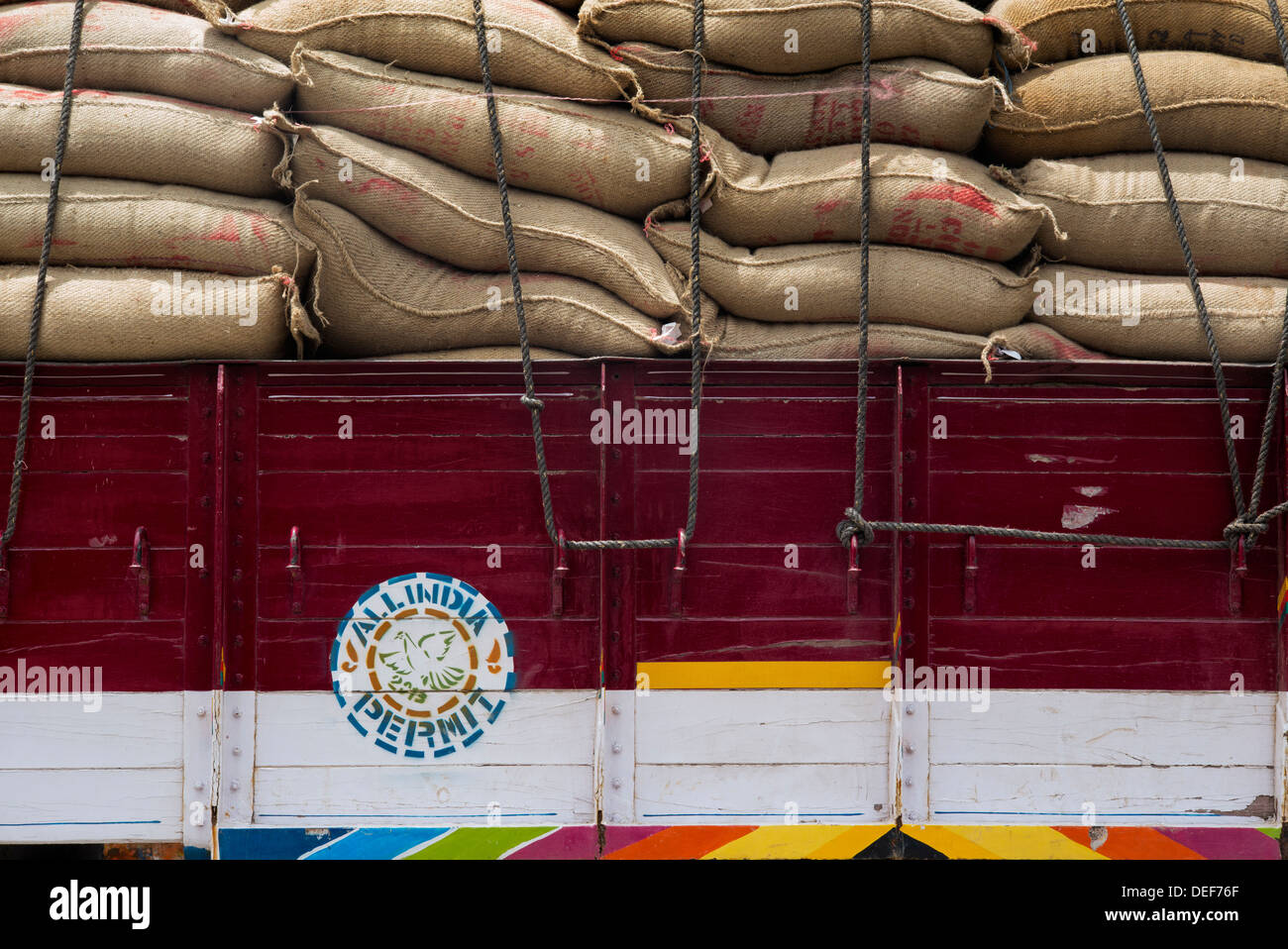 Indian lorry ladened with sacks of rice . Andhra pradesh, India Stock Photo