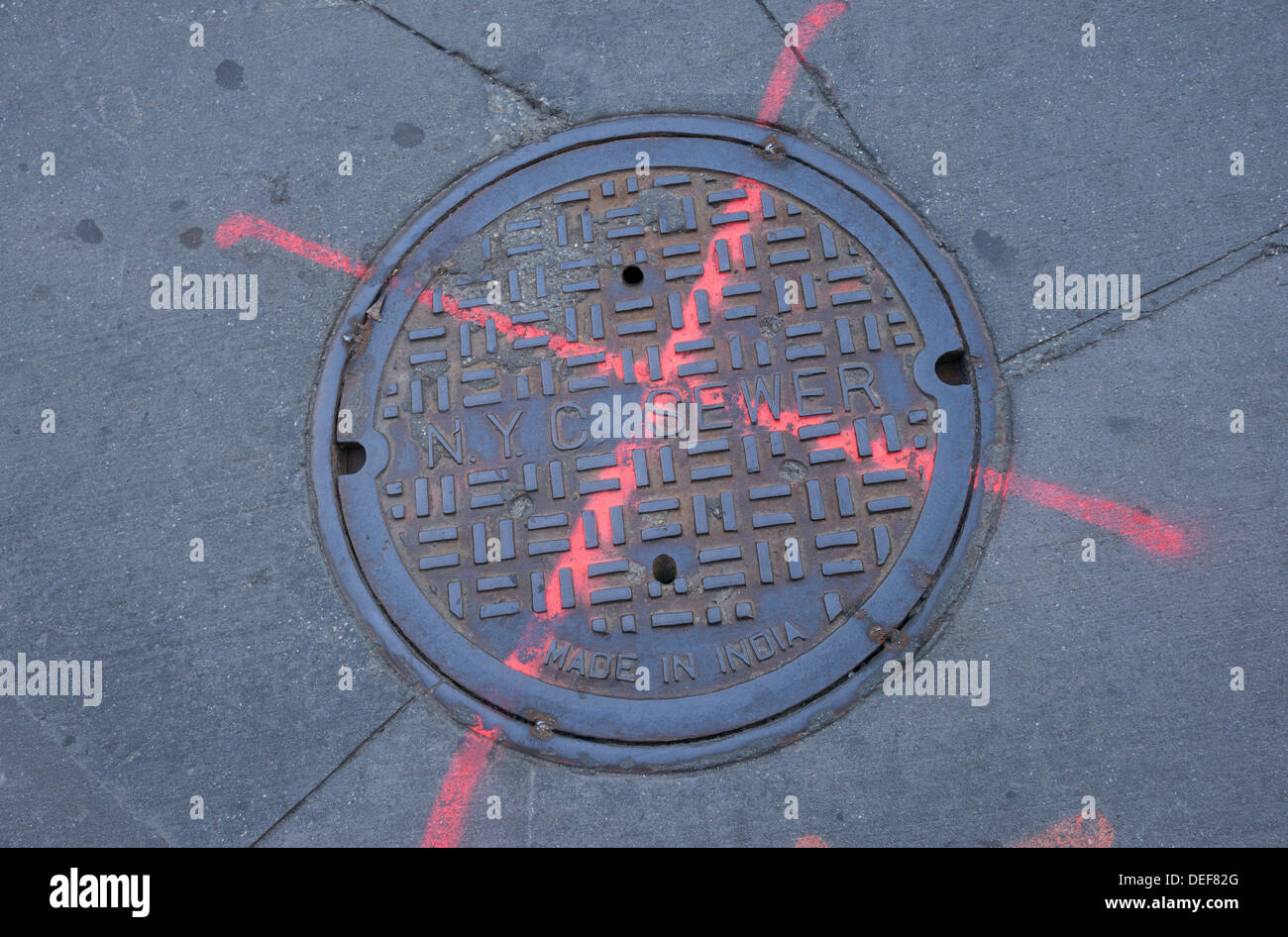 Manhole cover for access to the New York City sewer system - Stock Image