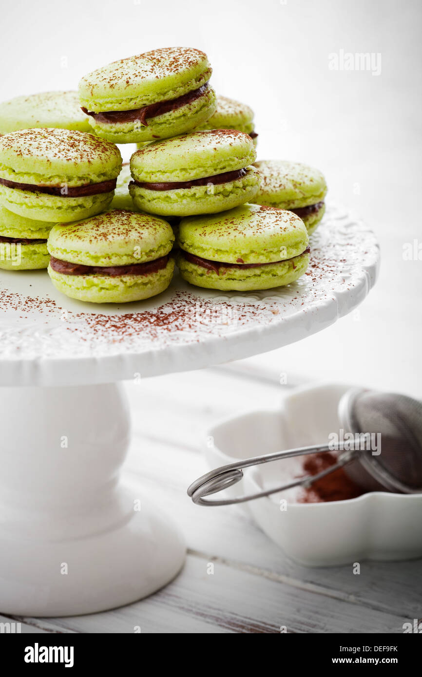 French macaroons in green with cocoa powder - Stock Image