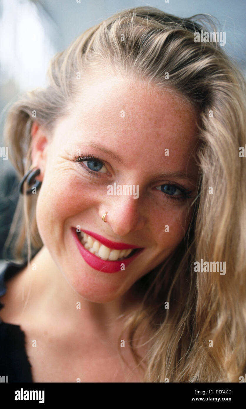4ae35cc0c55f6 Blonde woman wearing a nose ring Stock Photo  60573760 - Alamy