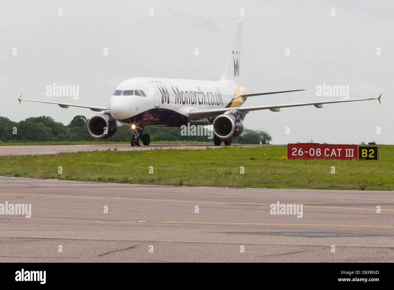 Monarch Airlines plane taxiing at Luton Airport - Stock Image