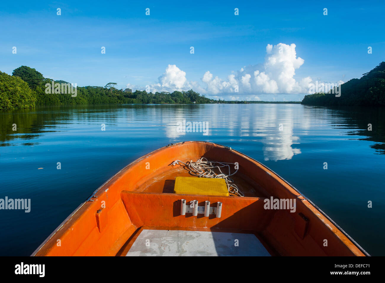 Boat cruising on a river in Pohnpei (Ponape), Federated States of Micronesia, Caroline Islands, Central Pacific, Pacific - Stock Image