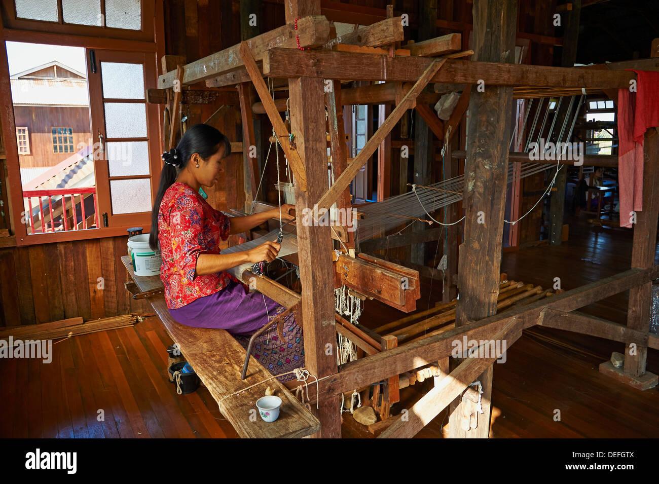 Burmese woman weaving, Nampan village, Inle Lake, Shan State, Myanmar (Burma), Asia - Stock Image