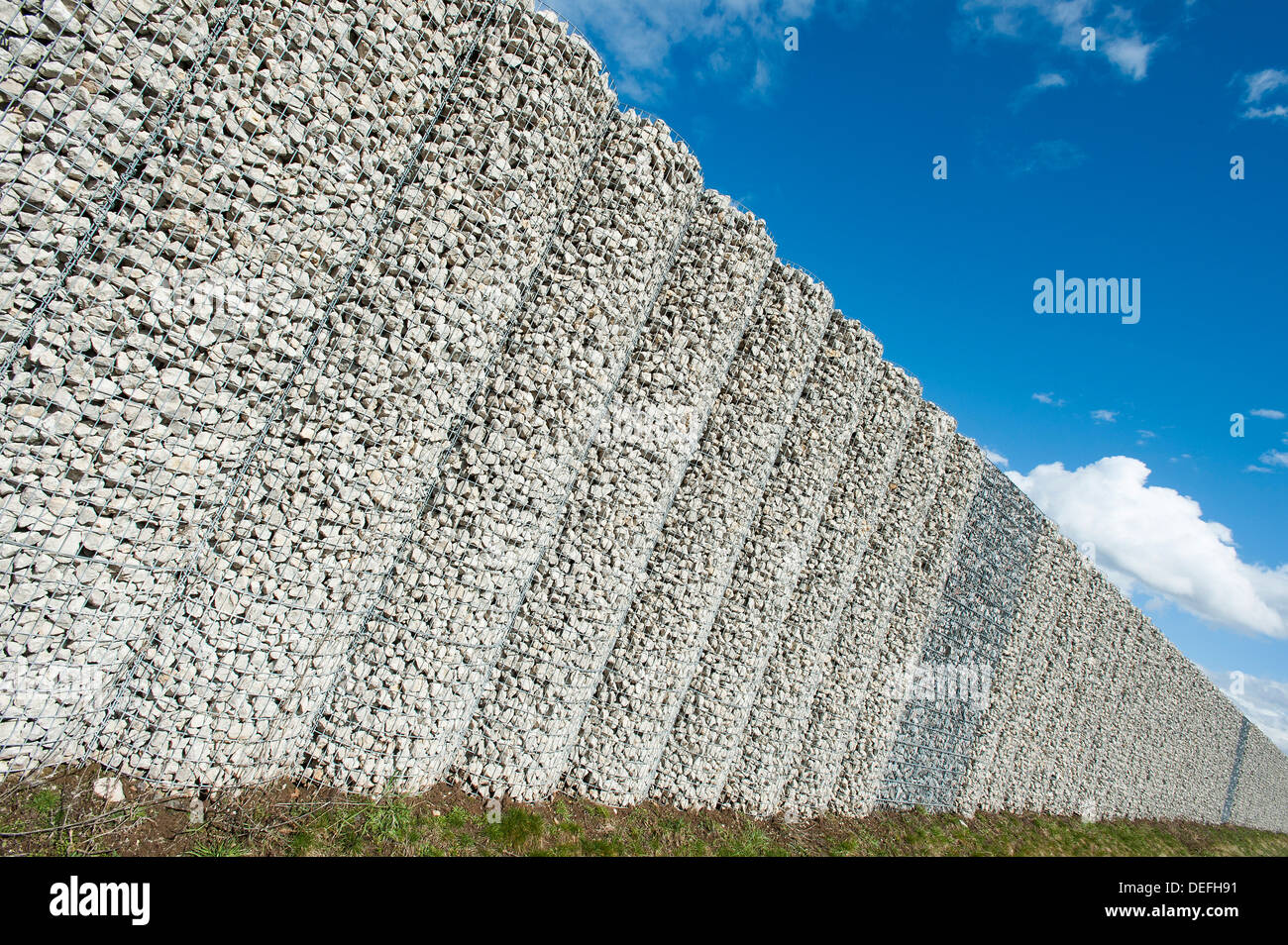 Gabion wall, mesh baskets filled with stones, noise protection wall on the Autobahn A9 motorway, Bavaria, Germany Stock Photo