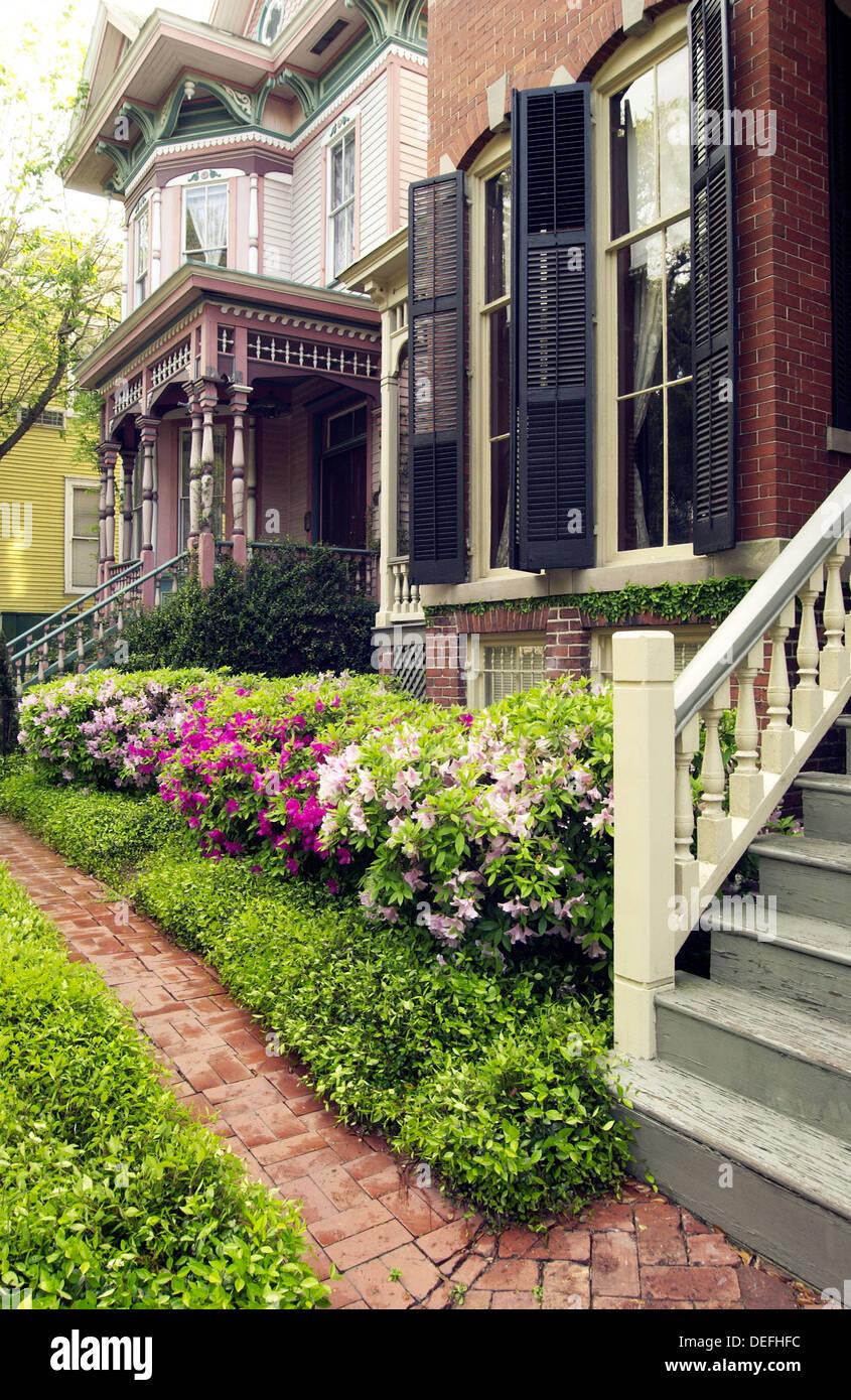Azalea blossoms and Victorian homes. Savannah. Georgia. USA - Stock Image